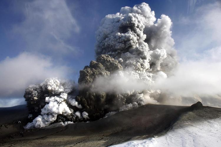 The volcano in southern Icelands Eyjafjallajokull glacier sends ash into the air .The Icelandic volcano that has kept much of Europe land-bound is far from finished spitting out its grit, and offered up new mini-eruptions