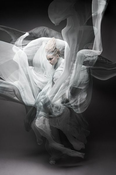 Element Photo Shoot Inspiration - A monochrome pained model & flowing fabrics give the illusion of smoke.