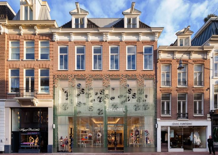 MVRDV used a pioneering glass technology to replace the brick facade of a former townhouse in Amsterdam with a transparent replica, more suited to the building's new use as a Chanel boutique.