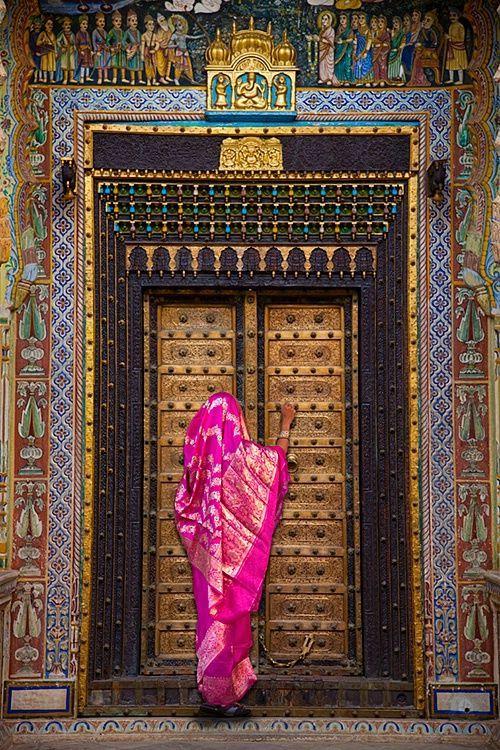 Woman in Sari and beautiful Door in the Bikaner Fort, Bikaner, Rajasthan, India by Jim Zuckerman