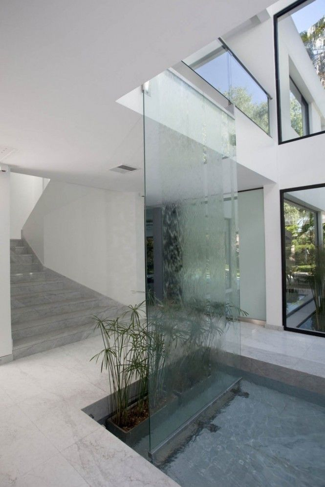 To continue the inside-outside feel, the architect has included a decorative indoor pool as part of a large yet understated water feature <3