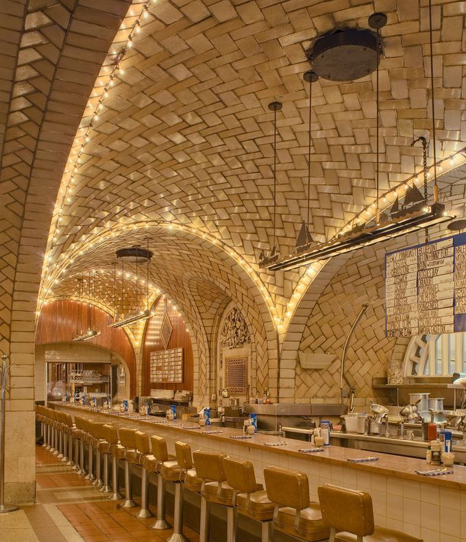 "Grand Central Oyster Bar & Restaurant, New York (1913) Guastavino tiles embellish the Oyster Bar, pictured here, and the acoustical, architectural ""whispering gallery"" just outside its entrance. When a visitor whispers in one of the gallery's four corners, the sound will carry up through the timbrel vaulted ceiling and across diagonally to another corner. Photo: Michael Freeman/Alamy"
