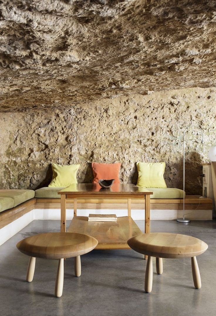 Ummo Estudio creates a new spatial experience that enhances the tectonic nature of the area through the use of new architectural elements  #cave #stone #livingroom