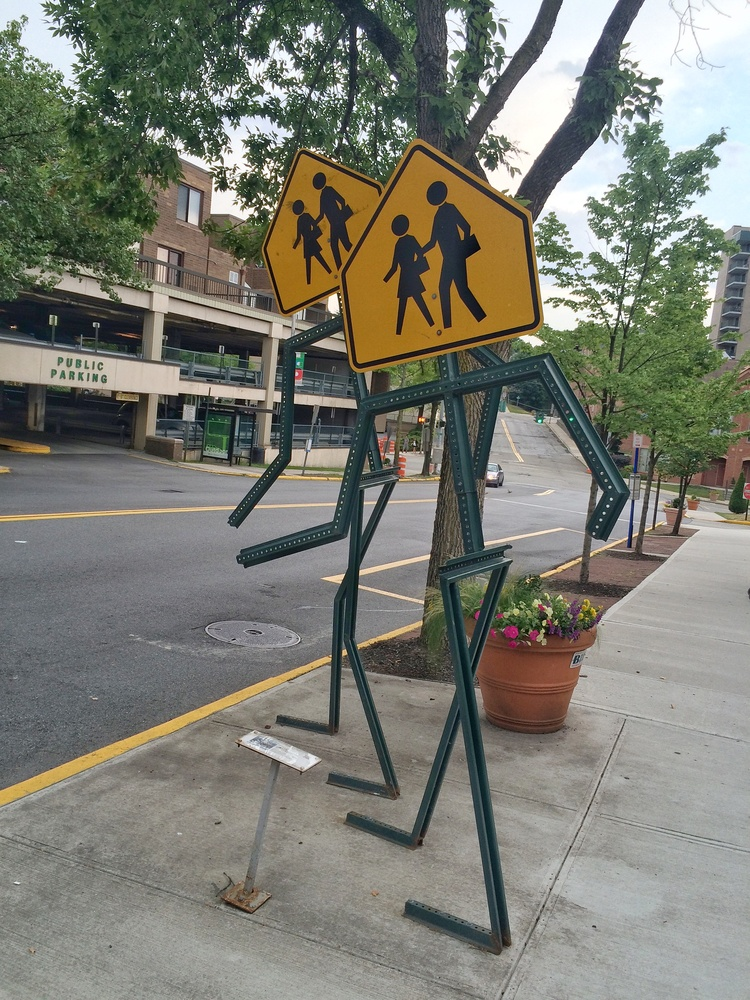 These pedestrian crossing signs look like pedestrians crossing the street