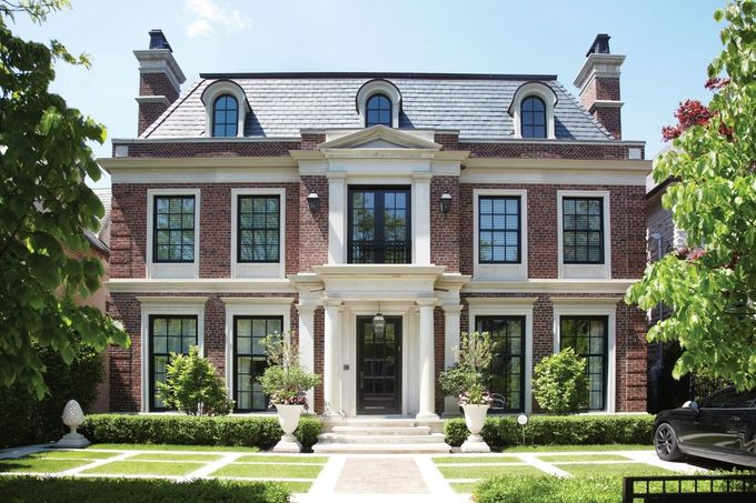 The detail in the brickwork on the exterior of this breathtaking Georgian custom design by ' Makow Associates marks it as a very special home.