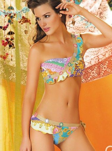 Paradizia Swimwear Rhapsodia Bandeau Two Piece Swimsuit     - Strong, decisive but yet delicate. Project all these qualities and more with this gorgeous two piece bandeau swimsuit and show everyone the gorgeous woman you are!   - Price $216