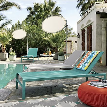 Minimalist outdoor reclining chaise lounge basks in tone-on-tone turquoise and a minimal price.