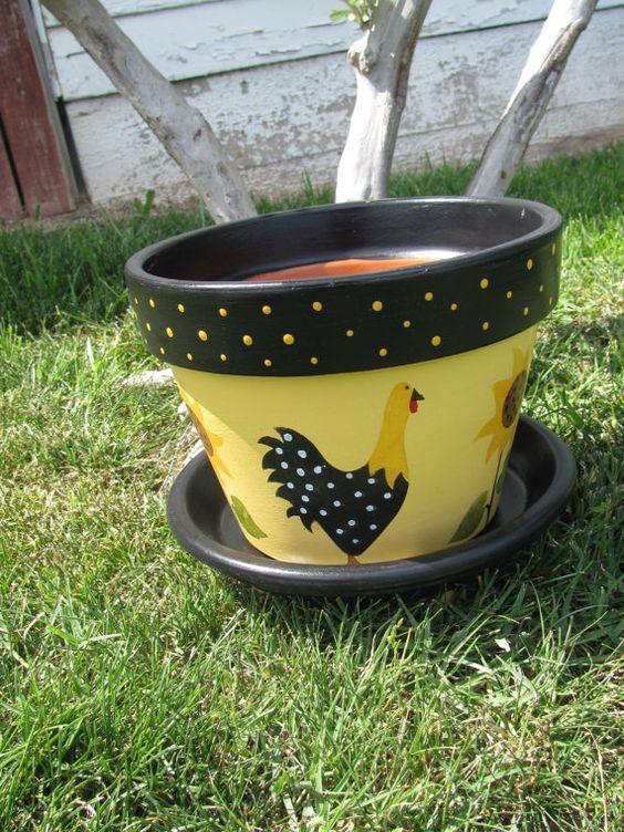 这是一个8英寸的赤土陶器花盆。锅被涂成黄色,并且在锅周围都是向日葵和鸡。包括茶碟,并绘制与花盆相匹配。排水孔直接位于锅的中心。花盆和碟子内外涂有防水清漆。根据要求定制和个性化!