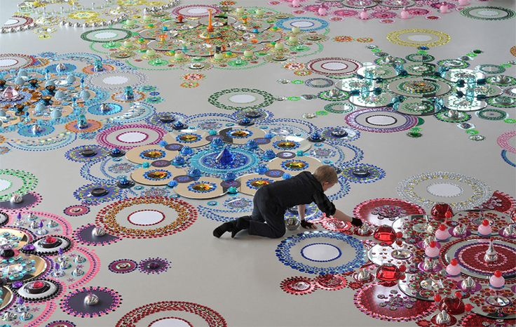 Kaleidoscopic floor installations made with thousands of individually placed mirrors, crystals, chromed metal objects and optical glass by Suzan Drummen.