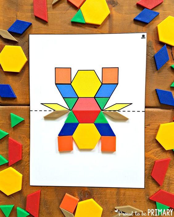 学习和建立与孩子们的几何形状和形状活动。包括有趣的数学活动和一个免费的模块块对称活动!