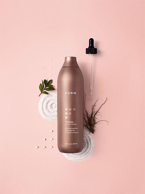 marketing poster graphic design, juxtaposition, flat lay, c4d digital art, warm color palette, bronze, pink, pastel brown, white sand, FORM's Hydrate.