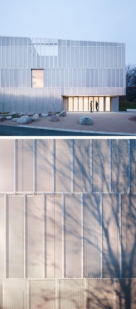 Perforated metal facade by Architecture 00. Designed to eventually become a framework for climbing plants.:
