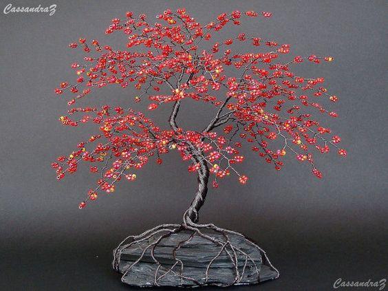 """红樱花串珠盆景〜高度:8""""宽度:9""""交货期:2-6周(全部近似)樱花树发现自己都穿着秋天的颜色。这个美丽的串珠树雕塑大多是红色的橙色,黄色和紫色珠子。适合秋季或一年中的任何时间。此列表适用于自定义/定制树。图中的确切树已售出。如果您购买此树,将为您制作另一个类似但仍然原始的树。请允许我2-6周制作你的树或先与我联系,看看是否有可能发出紧急订单。数以千计的六种不同颜色的种子珠被扭曲成青铜色的铜线,以制作这种华丽的红樱花树。它大约8英寸高,9英寸宽。根部扭曲,卷曲,然后环绕板岩基地。底座的底部覆盖有防滑衬里。这棵树对我来说不会上镜......这些照片只是不公平。这将是一个很棒的礼物! -------------------------------------------------- ------需要不同的��寸,形状或颜色?请与我联系,以便我可以帮助您创建自定义订单。我有许多不同颜色的电线和珠子可供选择。我也可以加入施华洛世奇水晶或宝石。自定义树木需要几天到几周才能完成,具体取决于我拥有的订单数量以及您想要的树木大小------------------- ------------------------------------在订购之前,请与我联系以获取定制订单或任何问题/要求所以我可以肯定我可以满足你的需求。运费价格是近似的,如果超额收费超过几美元,差价将退还。美国运费是优先邮件。国际航运费用为头等舱国际。如果您更喜欢Priority Mail,或者您的国家/地区未被引用,请与我联系以获取报价。在这里查看我的商店:http://www.etsy.com/shop/cassandraz"""