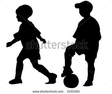 孩子的剪影|踢足球(男孩和女孩)股票照片的孩子剪影...