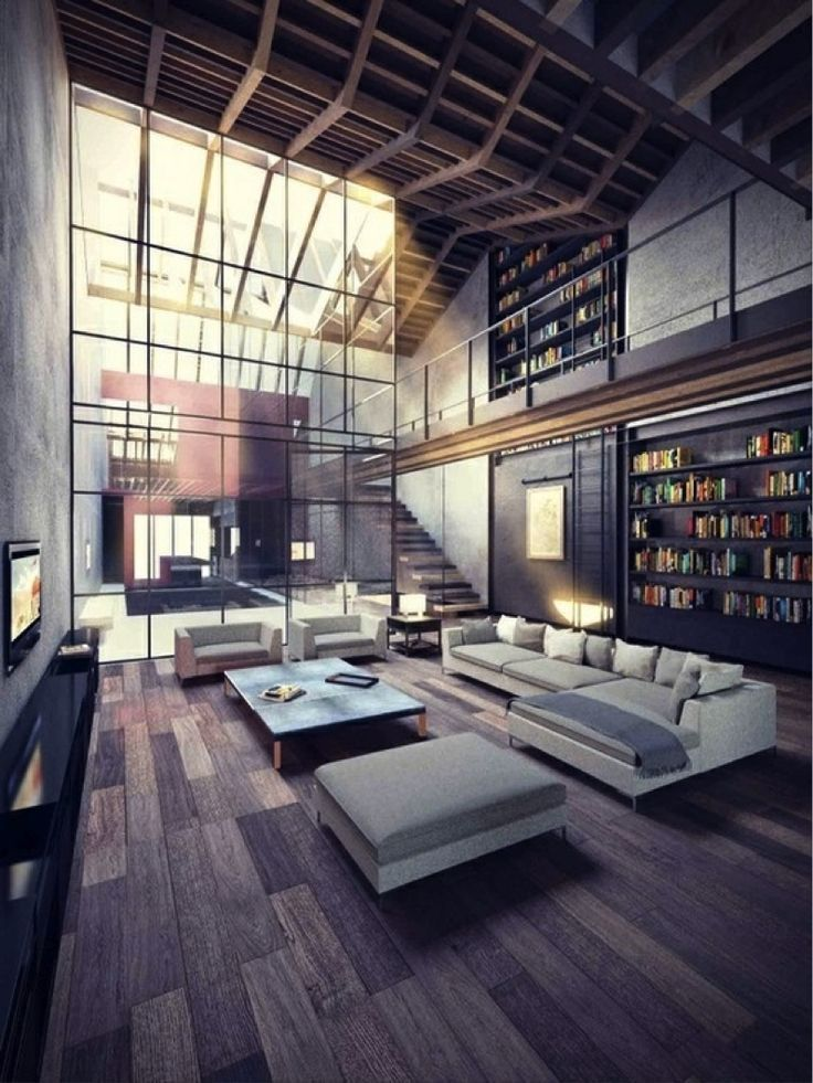 Modern, minimal + slightly #industrial #loft space. Love the low profile #furniture and large built-in #bookcases!