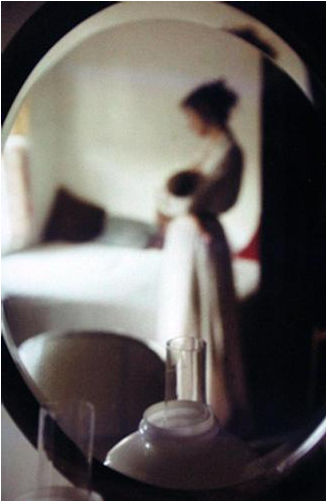 Mother & Baby In Mirror, 1950s by Saul Leiter