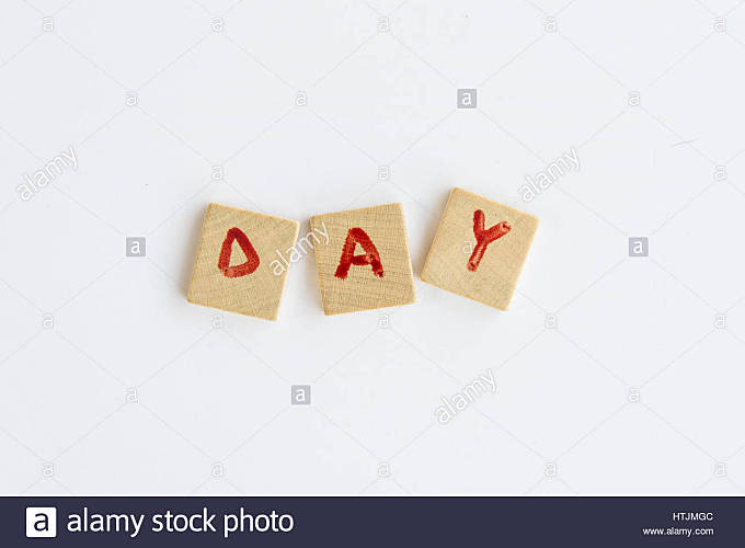 the word Day  formed with letters written on squares of wood dowels - Stock Image