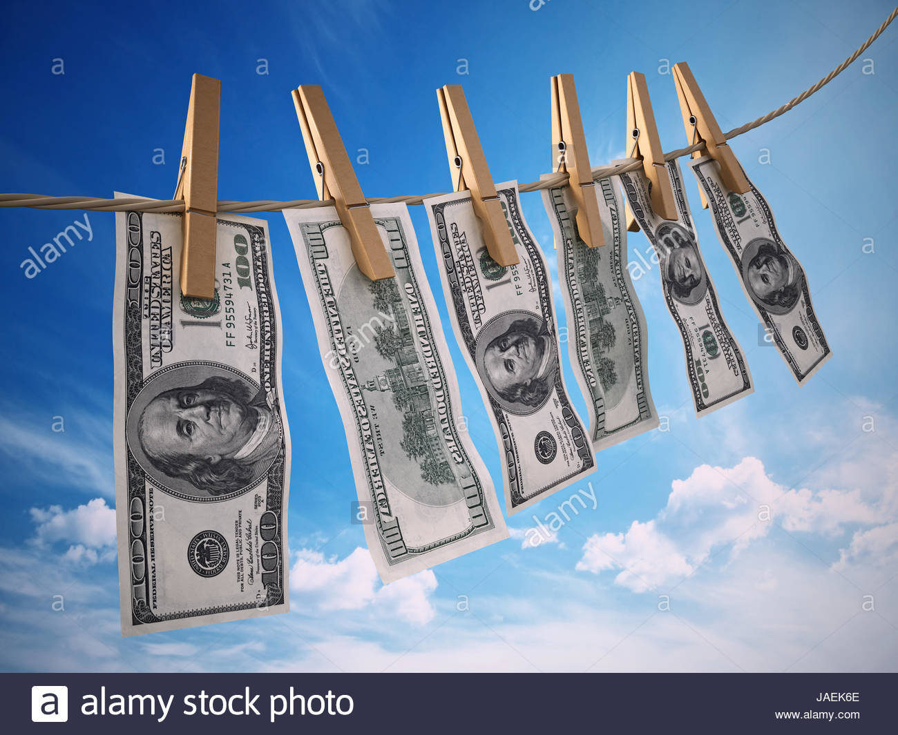 Money laundring concept with dollars hanging on the rope. 3D rendered illustration - Stock Image