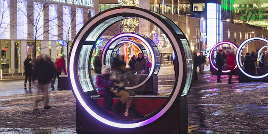 Illuminated Cylinders Displaying Fairy Tales when People Are Inside