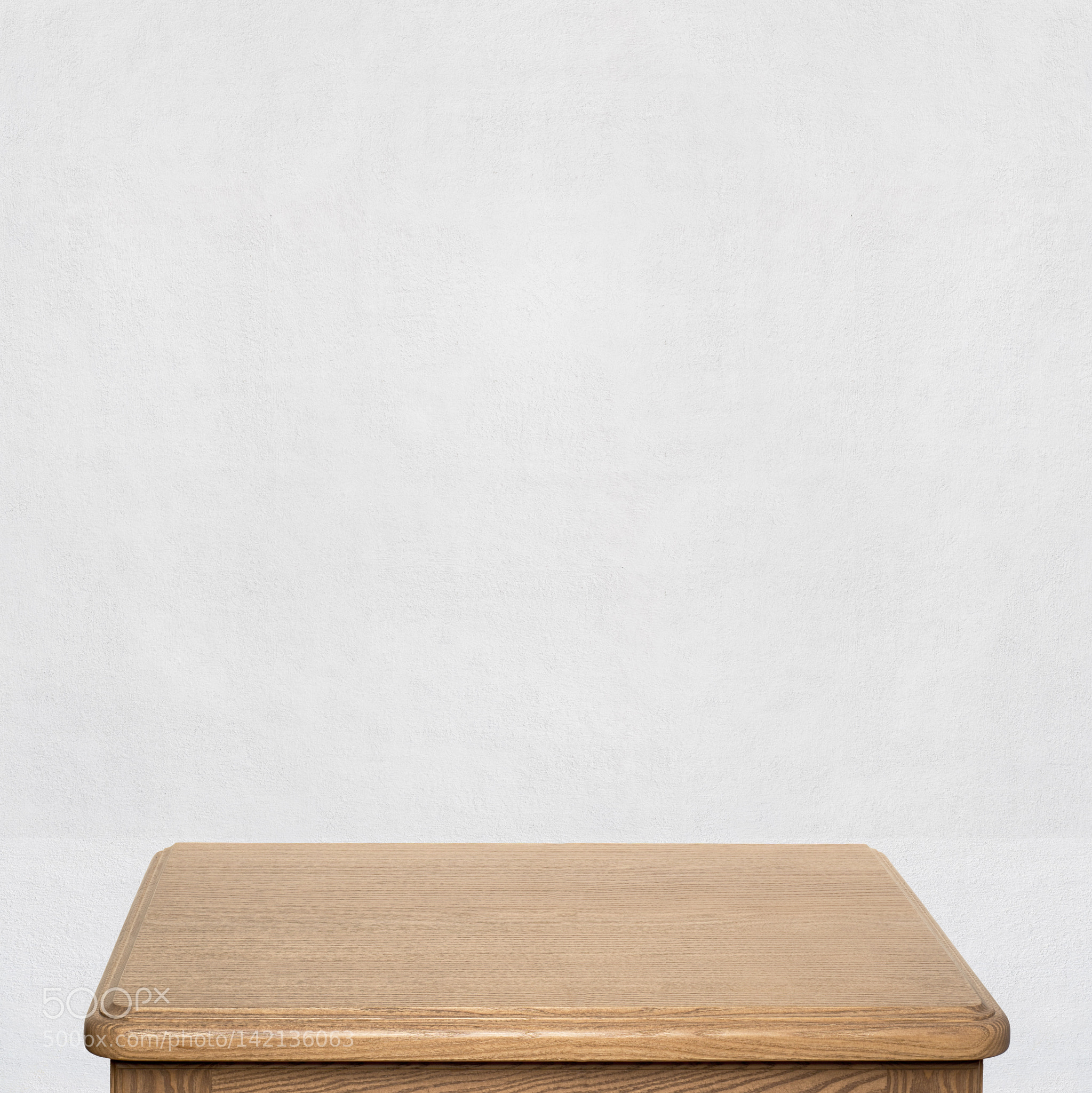 wooden table near the wall