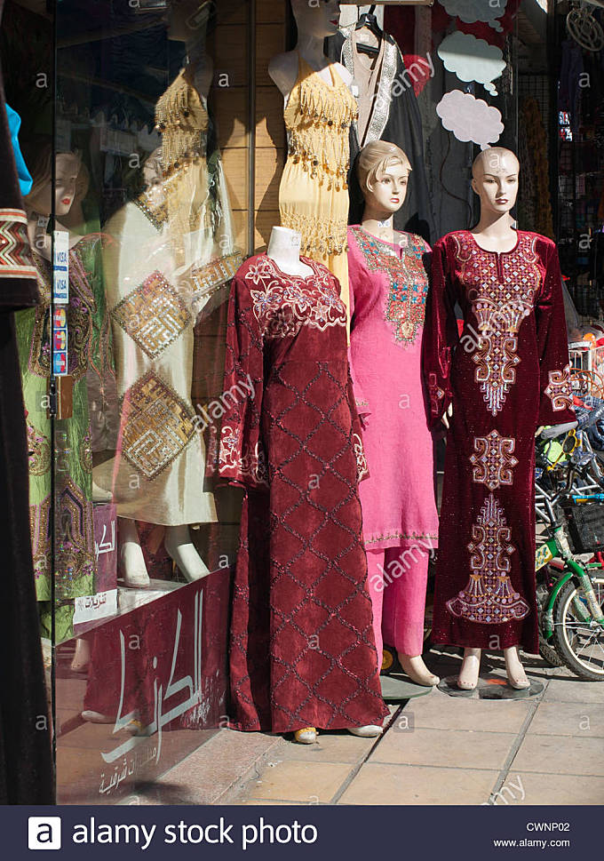 Display of Jordanian womens clothes on sale outside a shop in Aqaba Jordan - Stock Image
