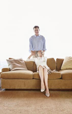 Older Caucasian couple relaxing in living room