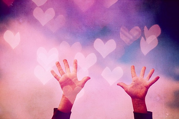 Hands on romantic and colorful background