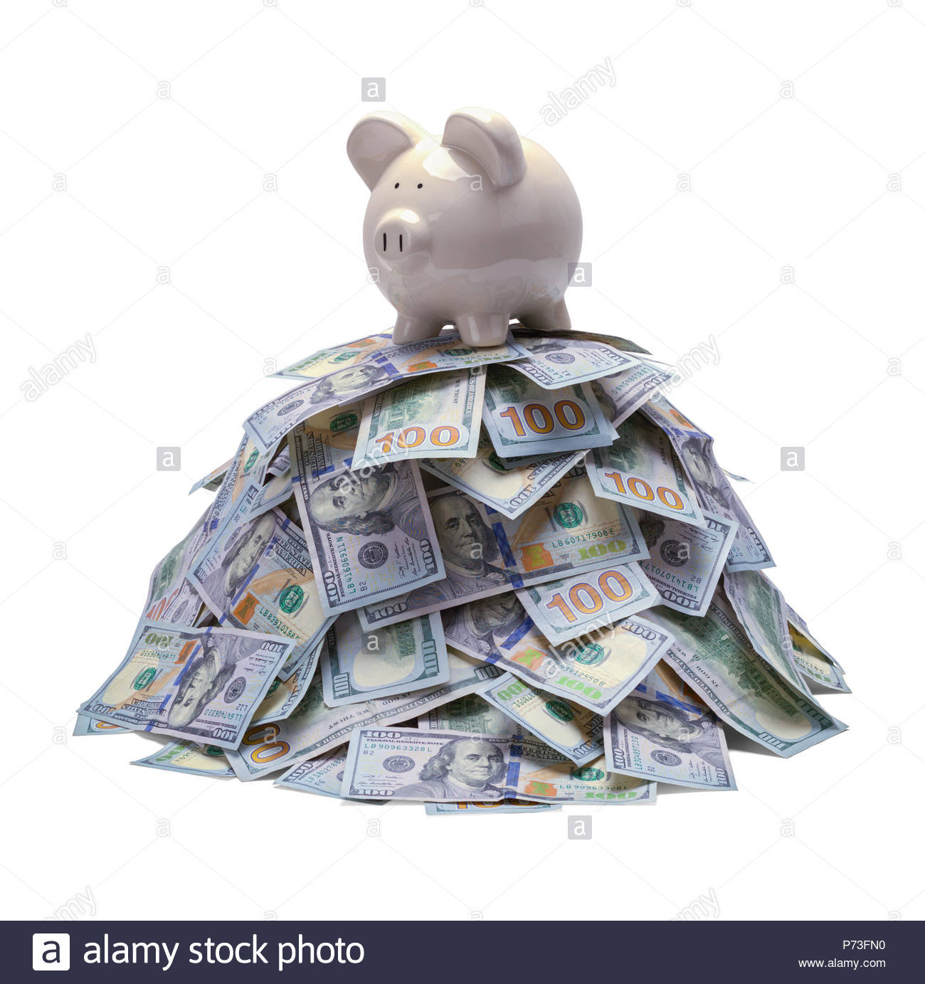 Pile of Money with Piggy Bank on Top Isolated on White. - Stock Image