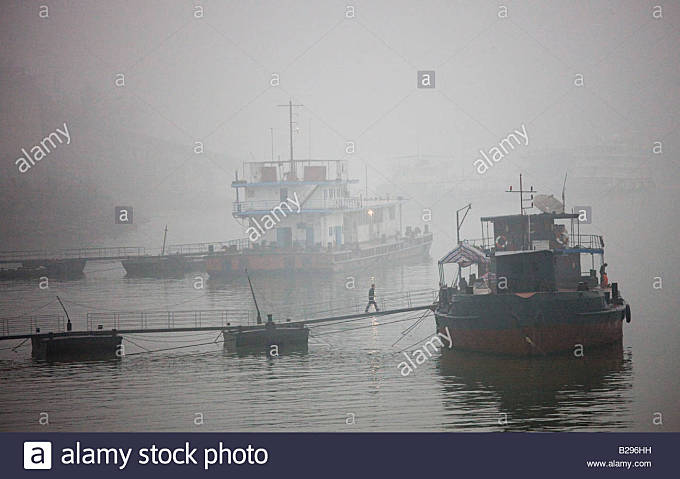 Tourist passenger cruiser boats moored on the Yangtze River China - Stock Image