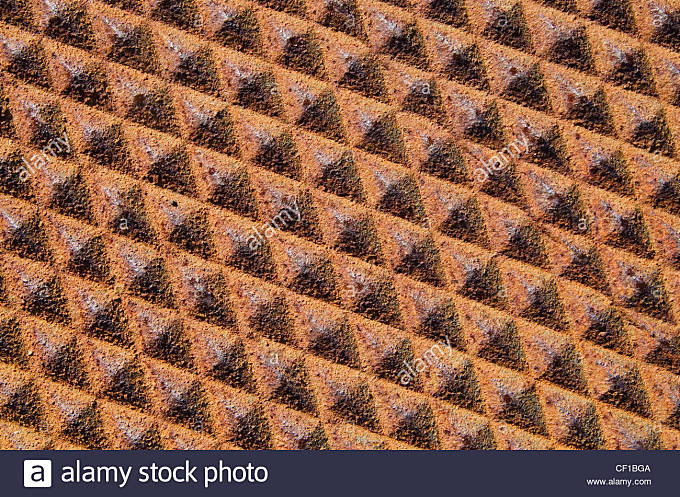 background of rusty iron metal with diamond texture pattern - Stock Image