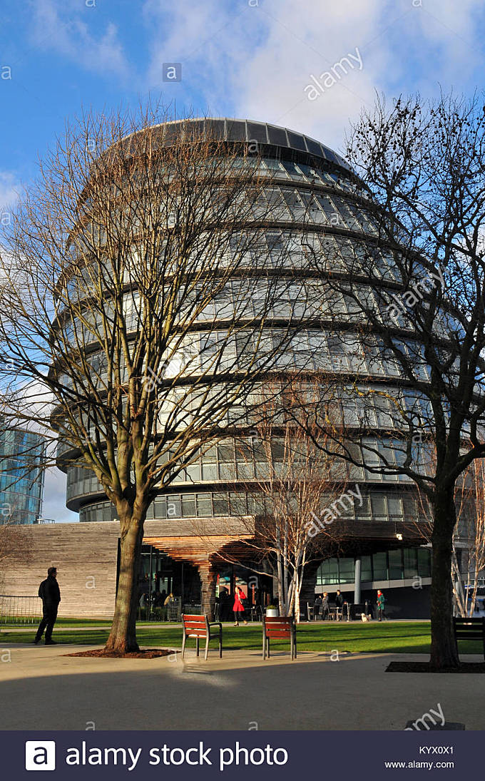 City hall on the south bank of the river Thames in London. The home or Greater London council or GLC. Iconic architecture - Stock Image