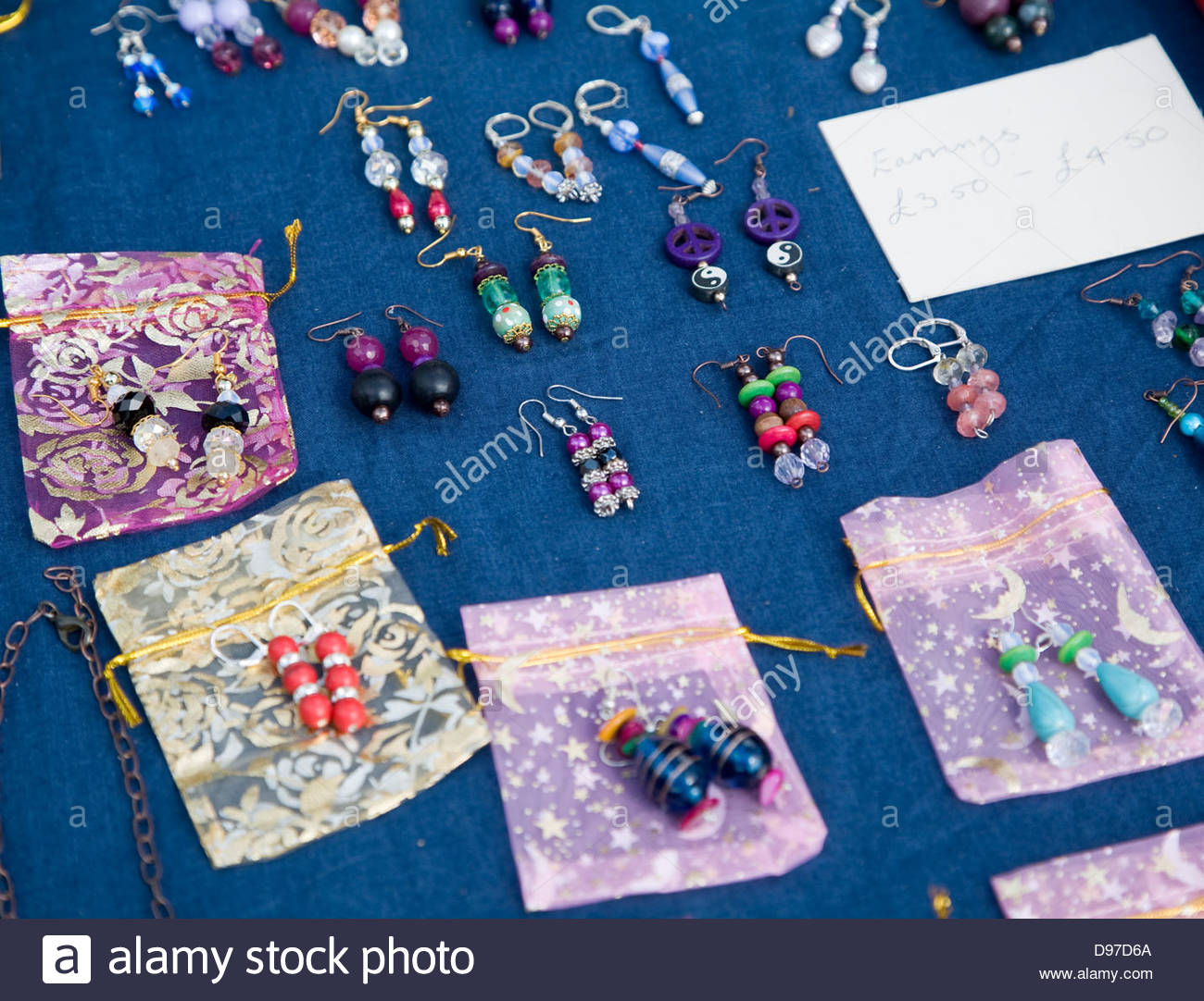 Display of handmade jewellery at country craft event, Shottisham, Suffolk, England - Stock Image