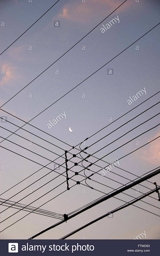 Crossing wiring electrical network and crescent moon in Bertioga - north coast of SP - Stock Image