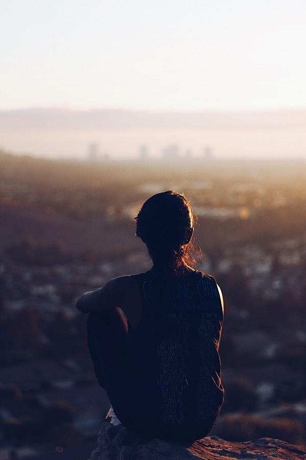 Woman Staring at Sunset