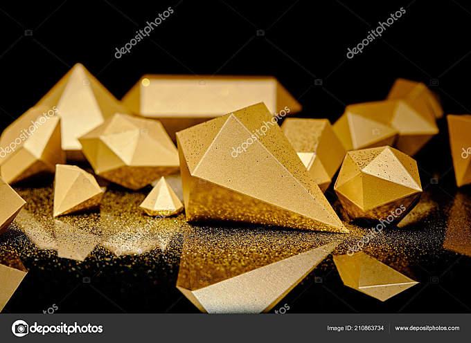 黑色闪烁的金色和金色的灰尘的特写视图