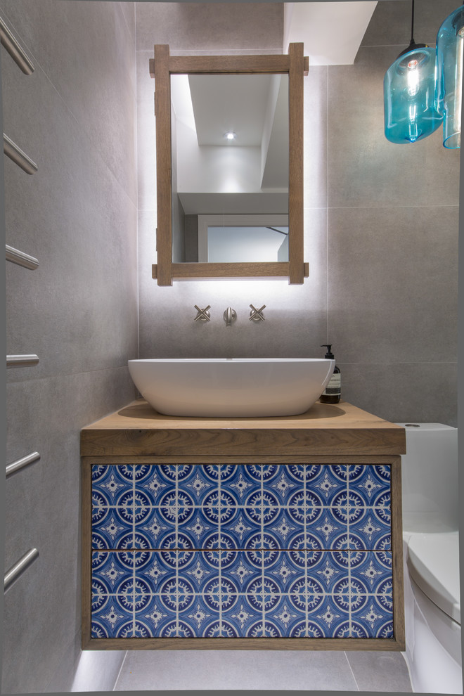 Eclectic Bathroom with Hand-crafted Tiles