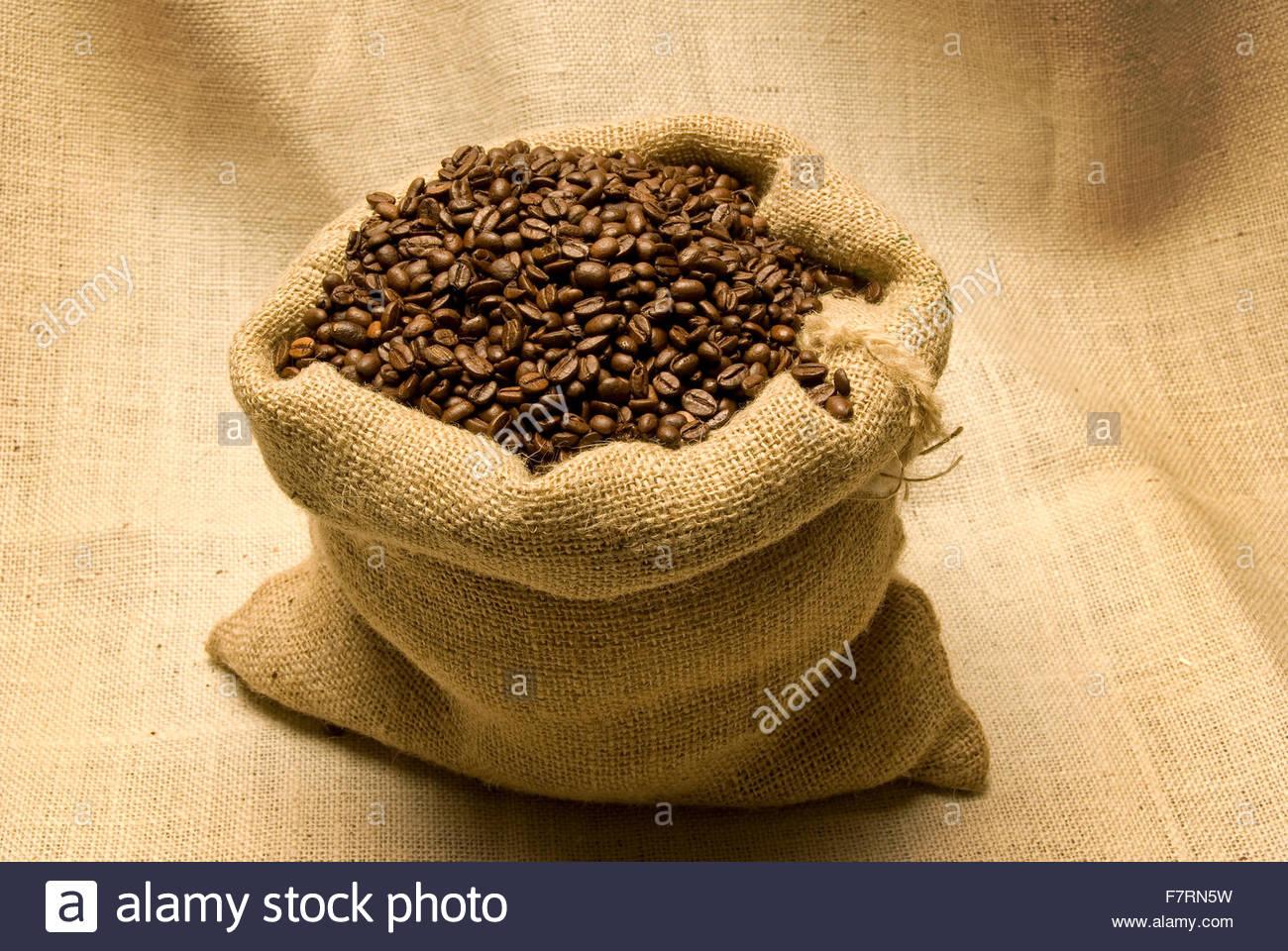 Burlap Bag Full of Coffee Beans - Stock Image