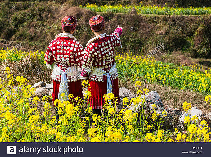 Young Miao women in the traditional costumes, Yunnan, China - Stock Image