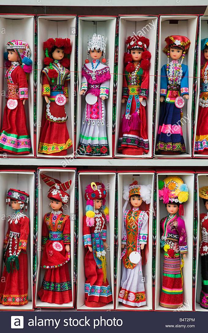 China, Yunnan Province, Dali, Dolls in Bai Minority People's Costumes, The Bai are the main ethnic group of - Stock Image