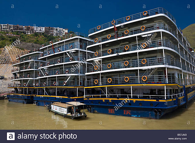 Three Yangzi River cruise boats tied up moored at the entrance to the Little Three Gorges at New Wushan JMH3406 - Stock Image