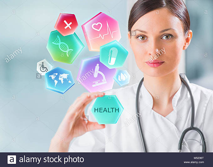 Female medical doctor working with healthcare icons. Modern medical technologies concept - Stock Image