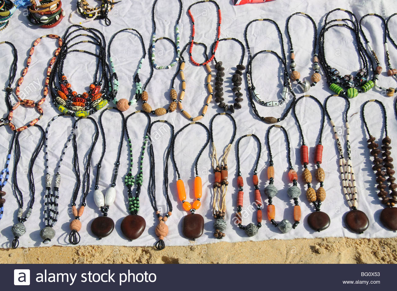 Jewellery sold by hawkers on beach at Saly, Senegal, West Africa, Africa - Stock Image