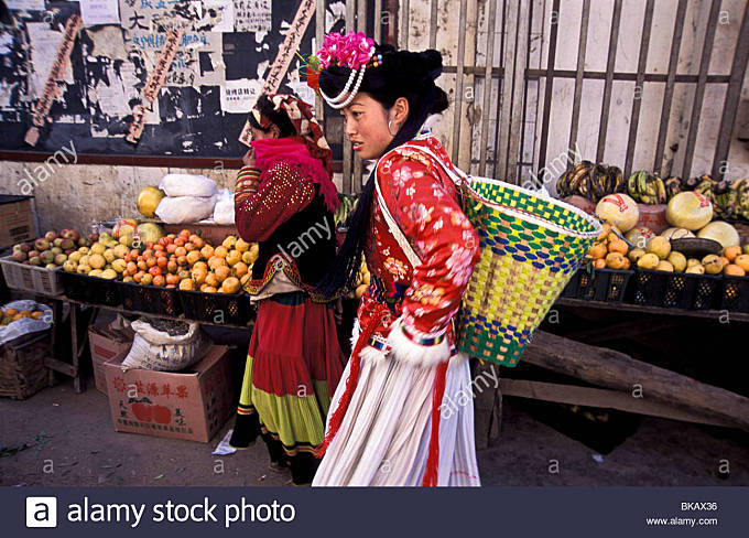 Mu Ze Latso a Mo Suo minority, with friend go shopping for groceries in Yongning town's market, Yunnan Province, - Stock Image