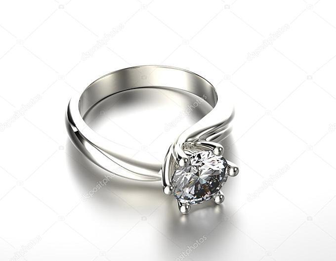金刚石或碳硅石的金色订婚戒指。