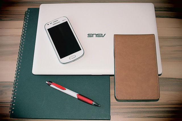 The white laptop and phone