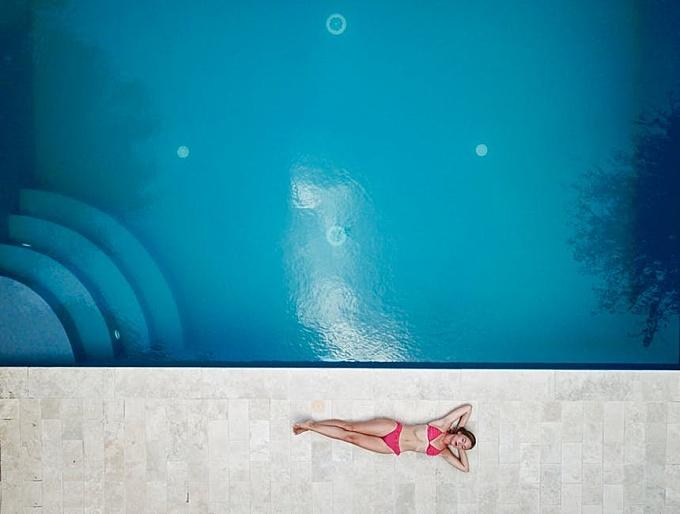 Woman Lying on Floor Near Pool