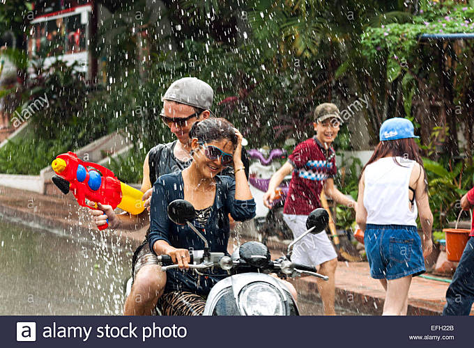 People celebrate Lao New Year (Pii Mai) and annual Water Festival in Luang Prabang, Laos, Asia - Stock Image