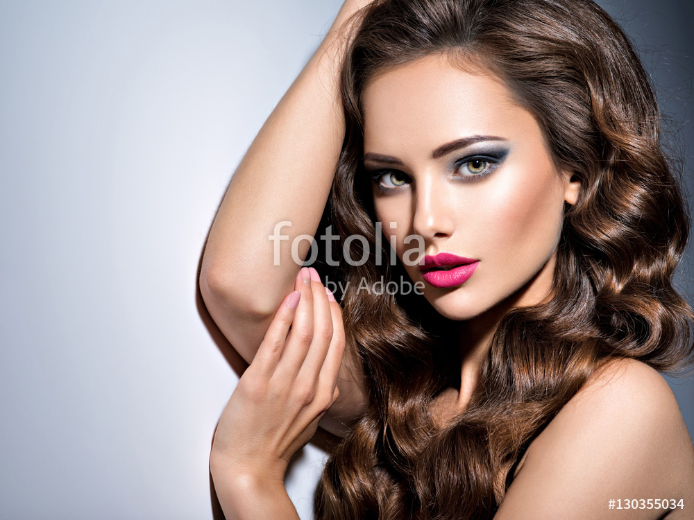 Photo: Pretty face of Beautiful woman with brown hair