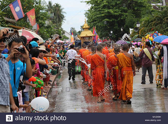 Watering the monks at Pi Mai Lao the Lao New Year Festival in UNESCO World Heritage Town of Luang Prabang, Laos, - Stock Image