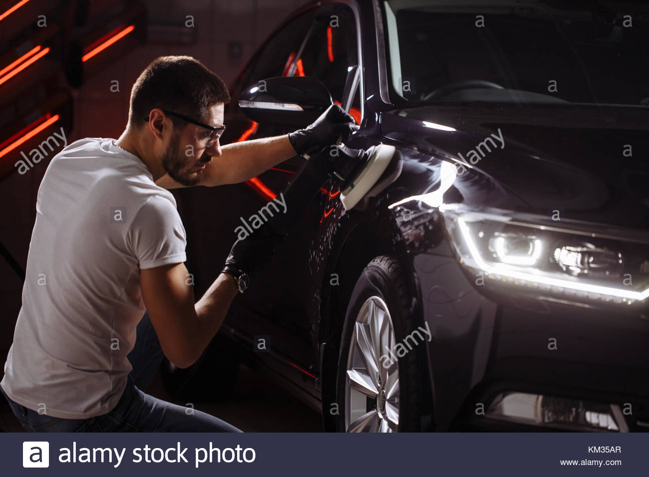 series of detailed cars: Polishing a car - Stock Image